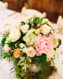 GARDEN Low Glass Arrangement consisting of peonies, hydrangea, roses, freesias, andromeda, hebe and pepper berry. Image by Nicole Cordeiro Photography.