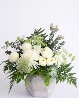 INDUSTRIAL Concrete Geo Vessel consisting of ranunculi, paper daisy, spider and pom pom chrysanthemums, succulents, Queen Anne's lace, textured foliages and ferns.  Image by The White Orchid Floral Design.
