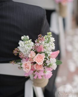 ROMANTIC Aisle Flower Posies consisting of roses, sweet peas and stocks.  Image by Luke Simon Photography.