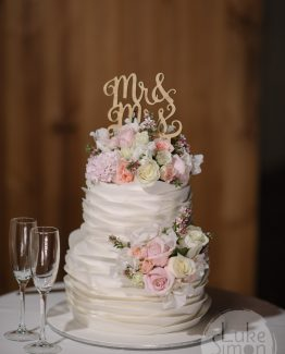 ROMANTIC Cake Flowers consisting of hyacinth, roses and sweet pea.  Image by Luke Simon Photography.