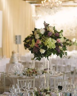 CLASSIC Large Tall Table Centrepiece consisting of roses, hydrangea and lilac.  Image by Luke Simon Photography.