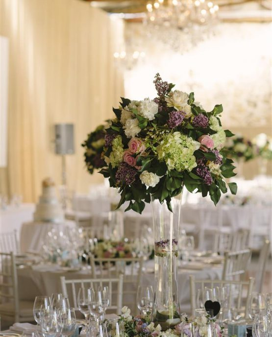 ROMANTIC Large Tall Table Centrepiece consisting of roses, hydrangea and lilac.  Image by Luke Simon Photography.