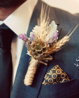 GARDEN buttonhole of scabiosa pods, lavender and wheat framed with dusty miller, finished with twine. Image by Kerin Burford Photography.
