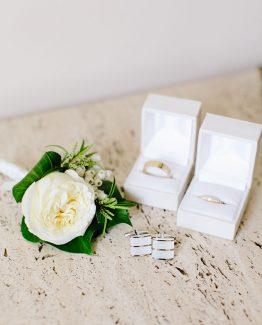 CLASSIC Amy Lu rose buttonhole finished with white satin ribbon. Image by Nicole Cordeiro Photography.