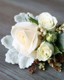 CLASSIC/ROMANTIC Dress Corsage consisting of rose, spray rose, andromeda and dusty miller.  Image by The White Orchid Floral Design.