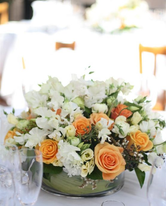 CLASSIC Low Table Centrepiece consisting of roses, lisianthus, ranunculi, sweet peas and ivy berry.  Image by The White Orchid Floral Design.