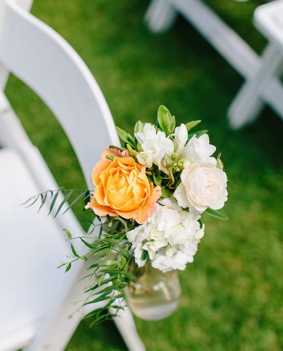 GARDEN Aisle Flower Posies consisiting of roses, freesia, hygrangea and pepper berry foliage.  Image by Nicole Cordeiro Photography.
