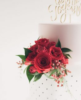 INDUSTRIAL Cake Flowers consisting of roses and pepper berry.  Image by Evan Bailey Photography.