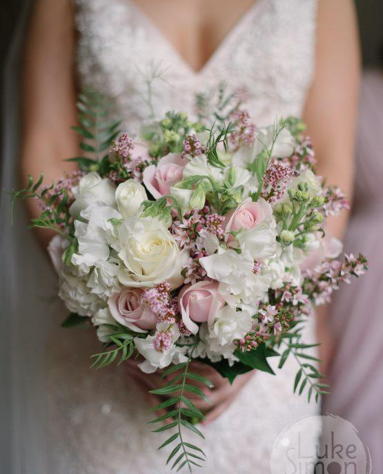 "GARDEN Bridal Bouquet ""Emily"" consisting of roses, stocks, sweet peas and pepper berry. Image by Luke Simon Photography."