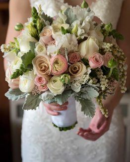 "CLASSIC Bridal Bouquet ""Claire"" consisting of roses, sweet pea, ranunculi, snap dragons, andromeda and dusty millar. Image by John Montesi Photography."