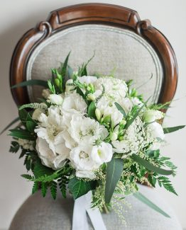 "INDUSTRIAL Bridal Bouquet ""Ashlea"" consisting of white hydrangea, freesia, scabiosa, pom pom chrysanthemums, snow berry, veronica, blue gum foliage and fern. Image by Jade Norwood."