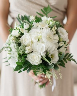 "INDUSTRIAL Bridesmaid Bouquet ""Ashlea"" consisting of white hydrangea, freesia, scabiosa, pom pom chrysanthemums, snow berry, veronica, blue gum foliage and fern. Image by Jade Norwood."