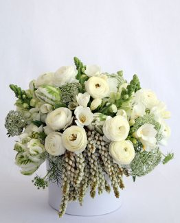 CLASSIC Ceramic Pot Arrangement consisting of ranunculi, parrot tulips, snap dragons, Queen Annes lace, freesias and andromeda.  Image by The White Orchid Floral Design.