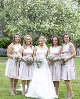 "CLASSIC Bridesmaids Bouquets ""Hayley"" consisting of ranunculi, roses, gypsophila and dusty miller. Image by Alice Healy Photography."