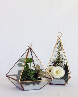 INDUSTRIAL Terrariums filled with petite plants, succulents or flowers.  Image by The White Orchid Floral Design.