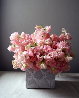 ROMANTIC Provincial Pot Arrangement consisting of sweet peas.  Image by The White Orchid Floral Design.