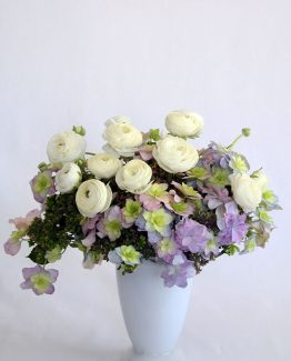 ROMANTIC White Glass Arrangement consisting of hydrangea and ranunculi.  Image by The White Orchid Floral Design.