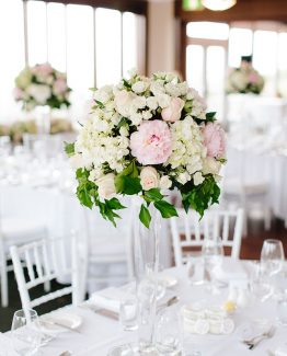 CLASSIC Large Tall Table Centrepiece consisting of hydrangea, roses, spray roses and peonies.  Image by Nicole Cordeiro Photography.