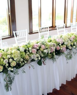 CLASSIC Bridal Table Hedge (3 meters) consisting of hydrangea, roses, spray roses, peonies, ivy berry and pepper berry.  Image by The White Orchid Floral Design.
