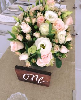 CLASSIC Low Rectangle Arrangements consisting of roses, spray roses and lisianthus. Image by The White Orchid Floral Design.