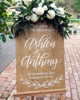 INDUSTRIAL Sign Spray consisting of white lisianthus, freesia, pom pom chrysanthemums, blue gum foliage and fern. Image by The White Orchid Floral Design.